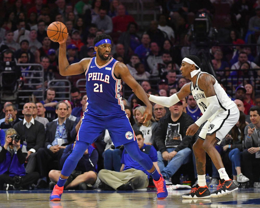 Mar 28, 2019; Philadelphia, PA, USA; Philadelphia 76ers center Joel Embiid (21) controls the ball against Brooklyn Nets forward Rondae Hollis-Jefferson (24) during the fourth quarter at Wells Fargo Center. Mandatory Credit: Eric Hartline-USA TODAY Sports
