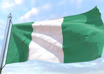 Flag of the country Nigeria weaving in the air. Flying in the sky.